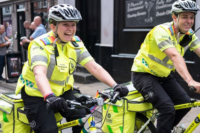 Two volunteers with the SJA cycle response unit at PRIDE festival