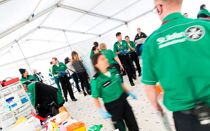 Busy First Aid treatment tent