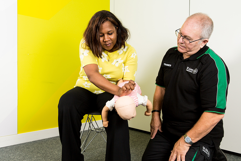 Delegate learning what to do when a baby is choking